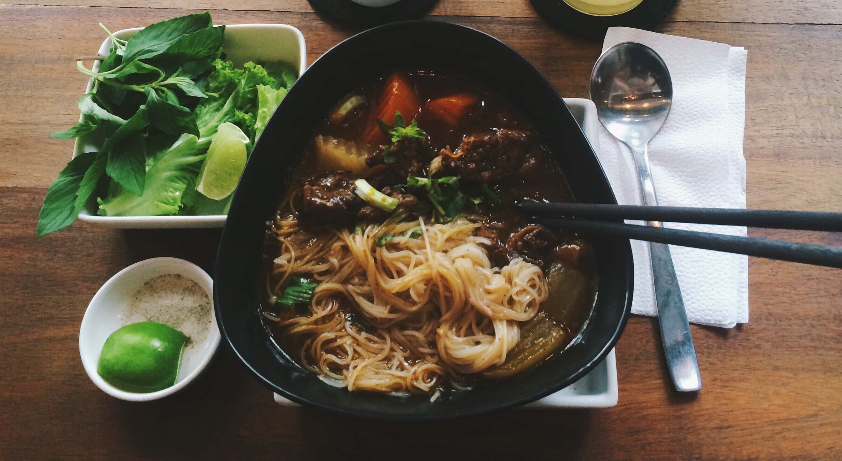 Vietnamese beef pho served with garnishes