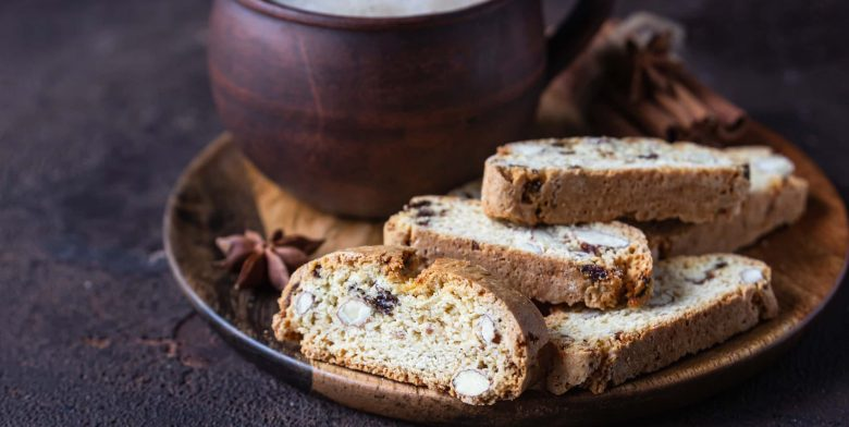 Almond biscotti on a wooden plate served with coffee