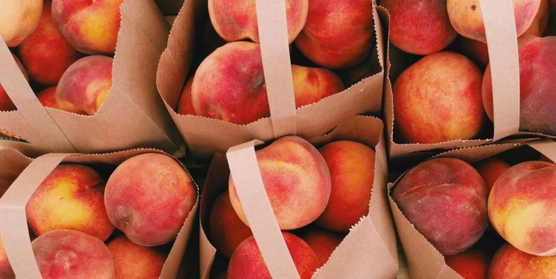 Bags full of Peaches in the Garden
