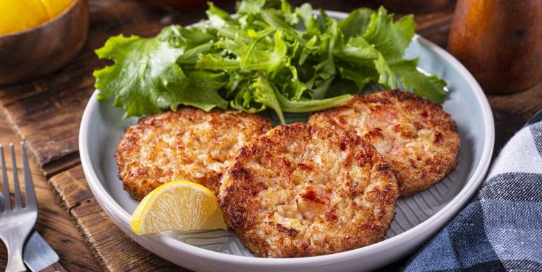 Crab cake served with a salad