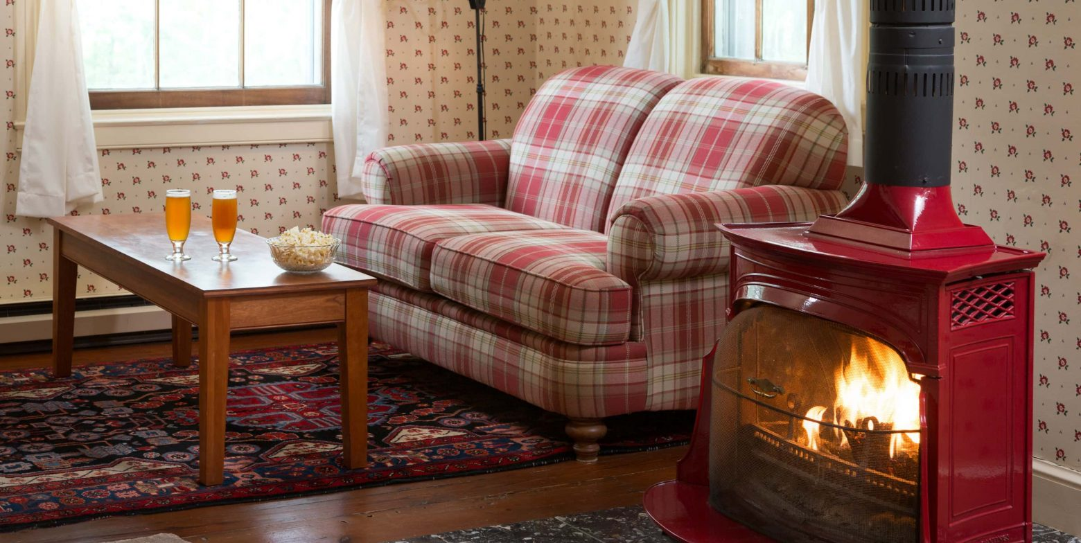 Cozy up next to the wood burning stove in the Red Room, a perfect winter getaway