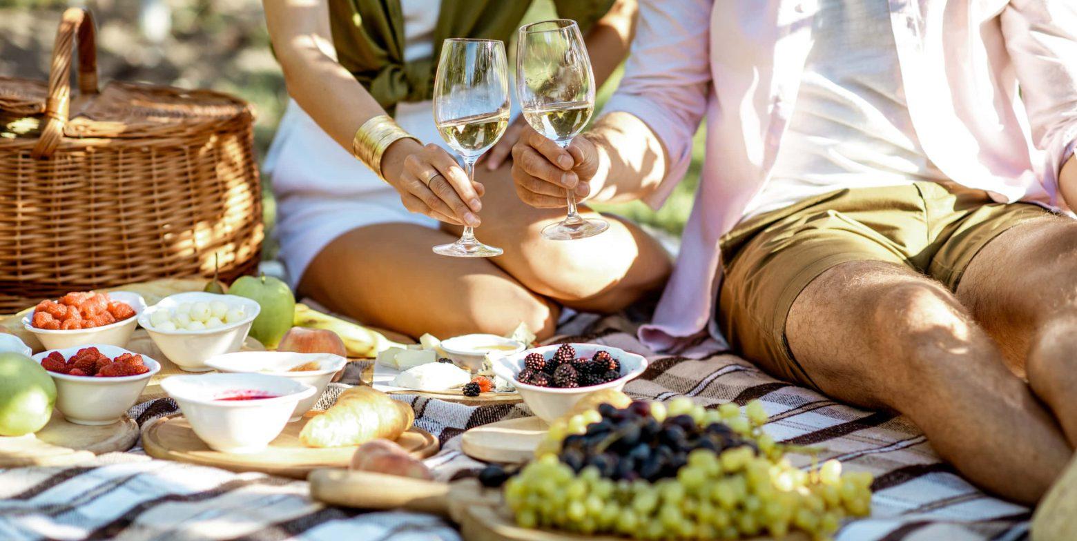Couple enjoying a romantic picnic outdoors