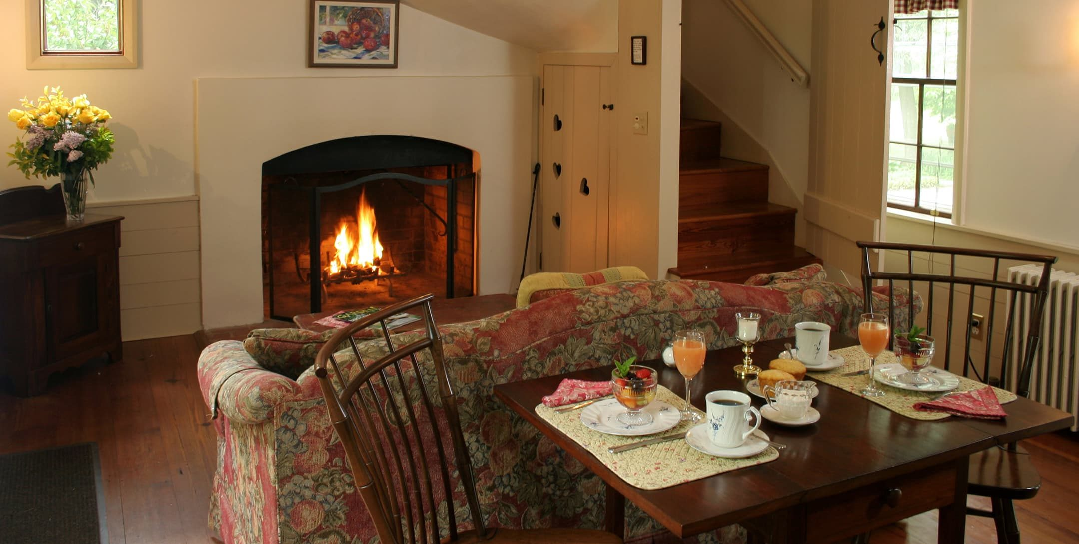 dining table and living room with fireplace in the Fairy Hill Suite
