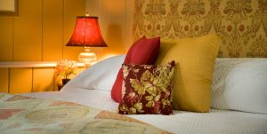 Pillows on a king bed in the Poppy's Retreat room at Brampton Inn