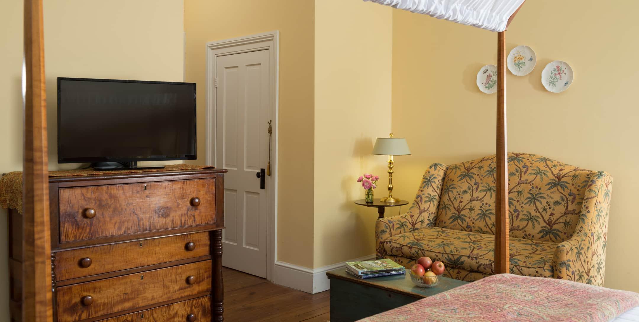Flatscreen TV on a dresser in the Yellow Room at Brampton Inn