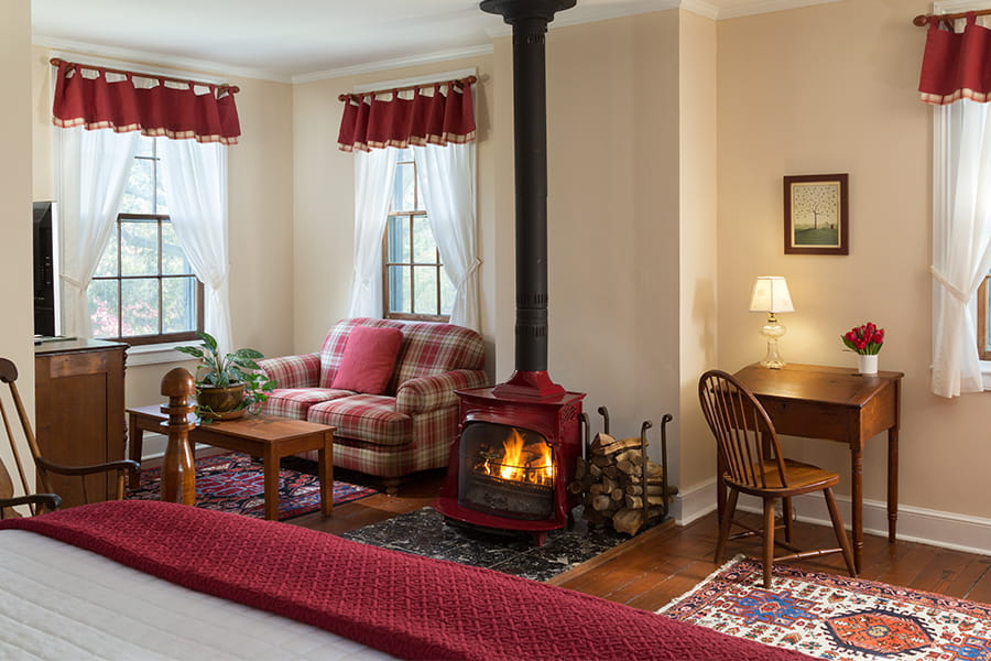 Red room bed and wood stove