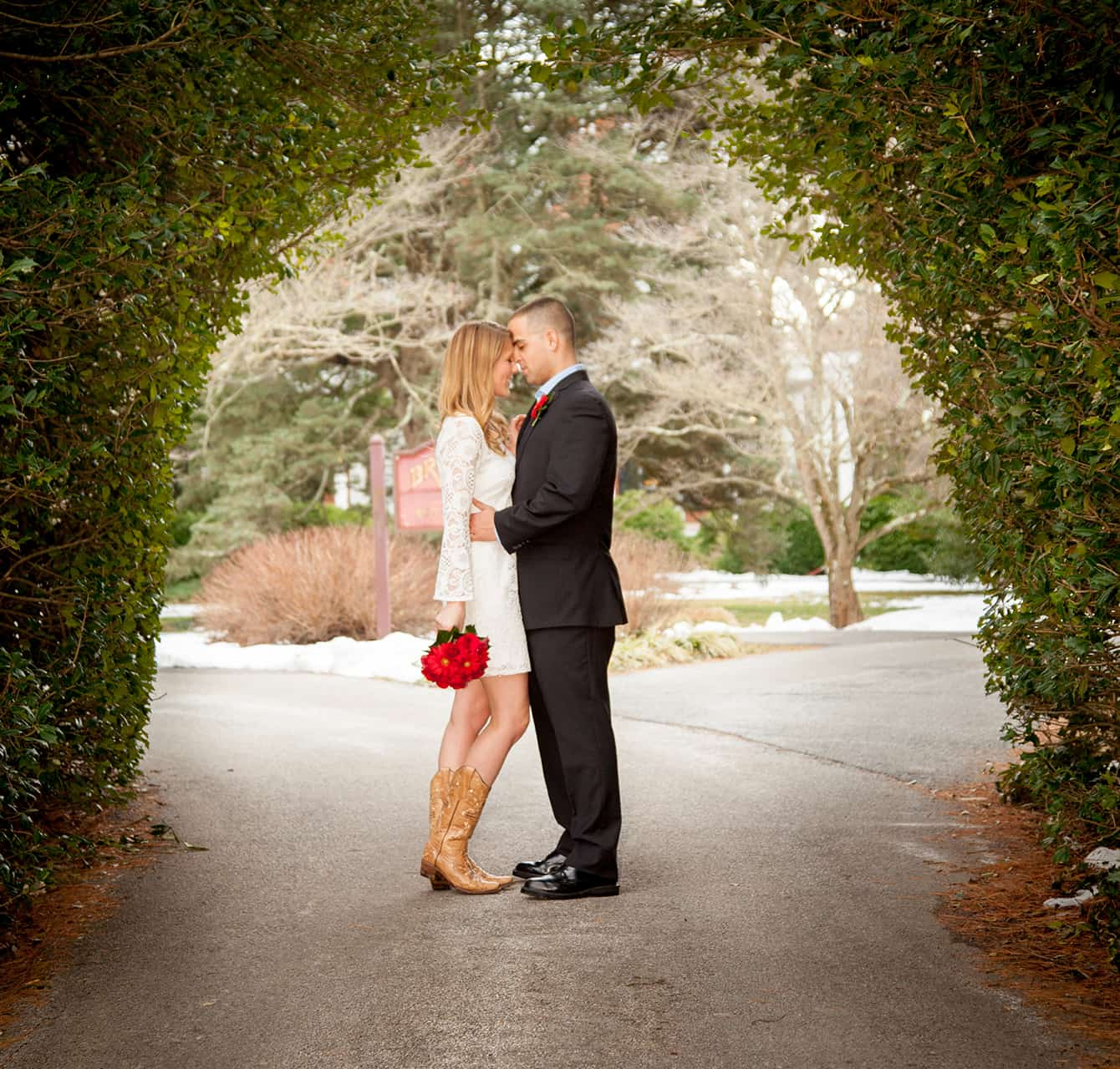Married couple under an archway of trees