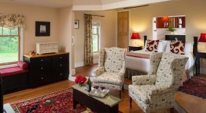 Fairlee cottage at Brampton Inn with a King bed and seating area for two