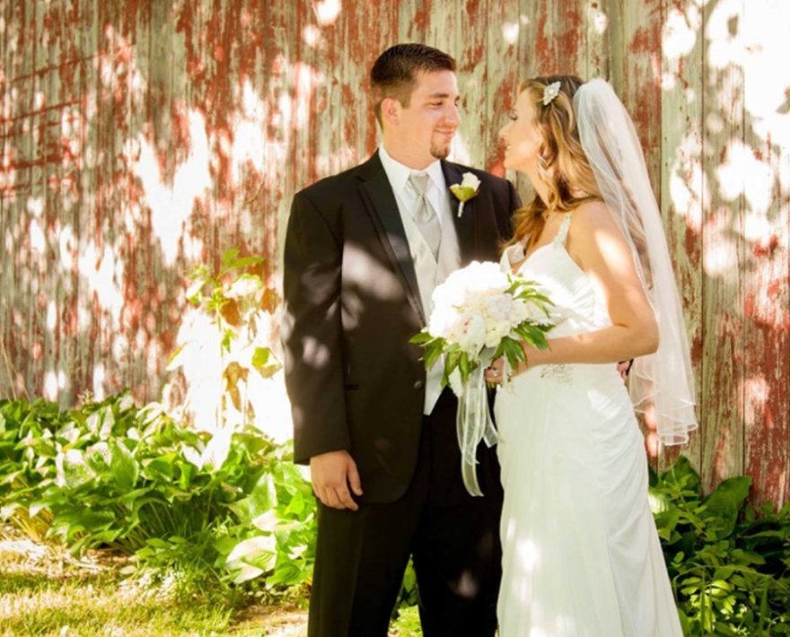Groom and bride in front of a building