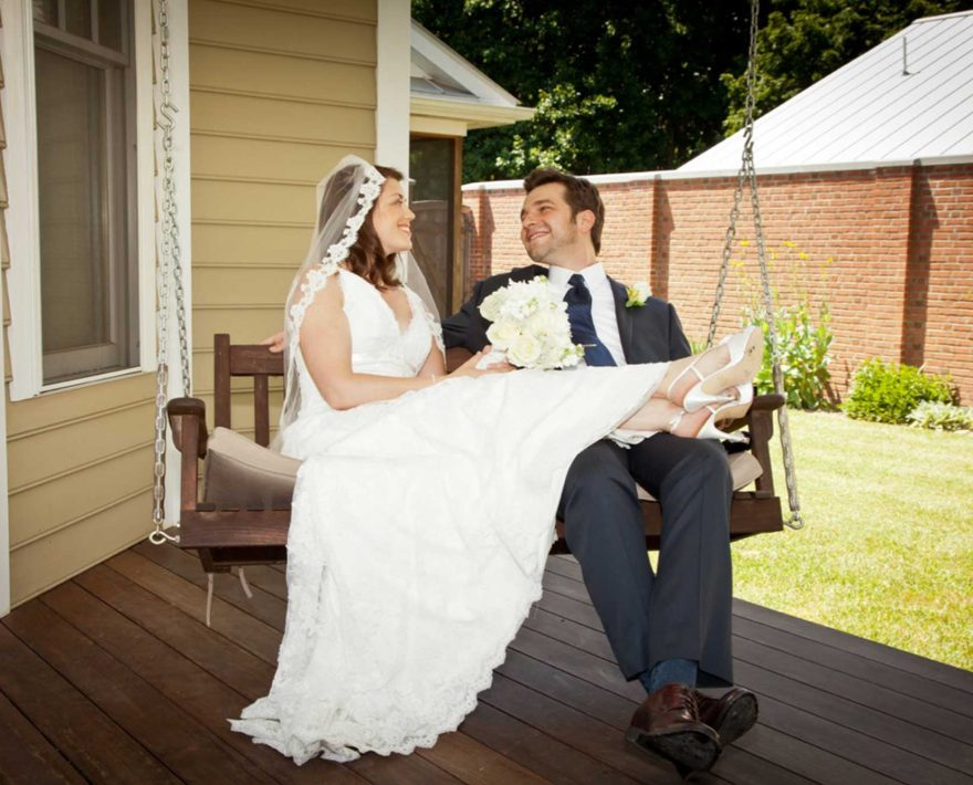 Bride and groom on a porch swing