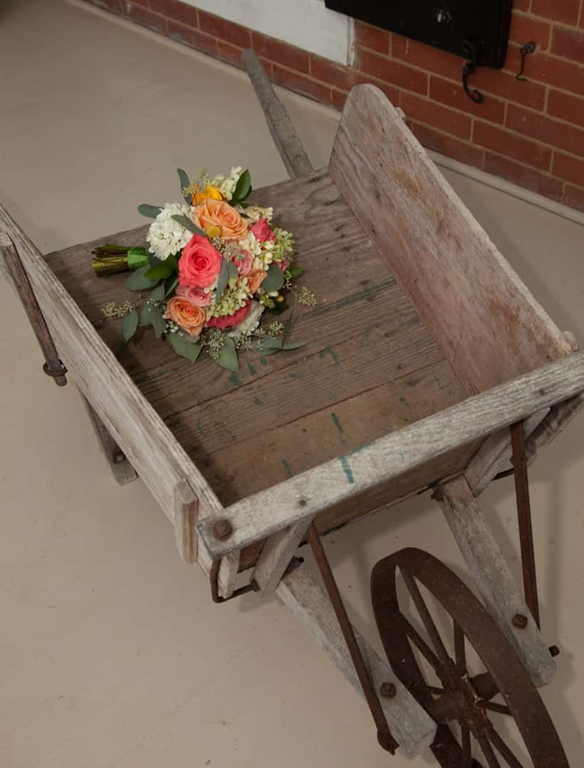 Wedding bouquet in wooden cart