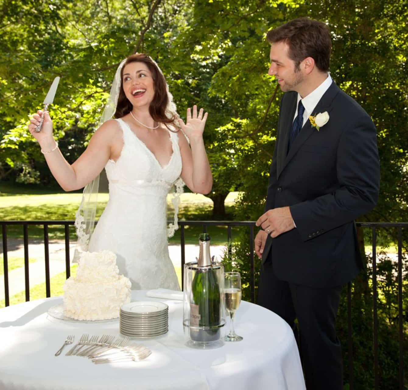 Married couple cutting wedding cake