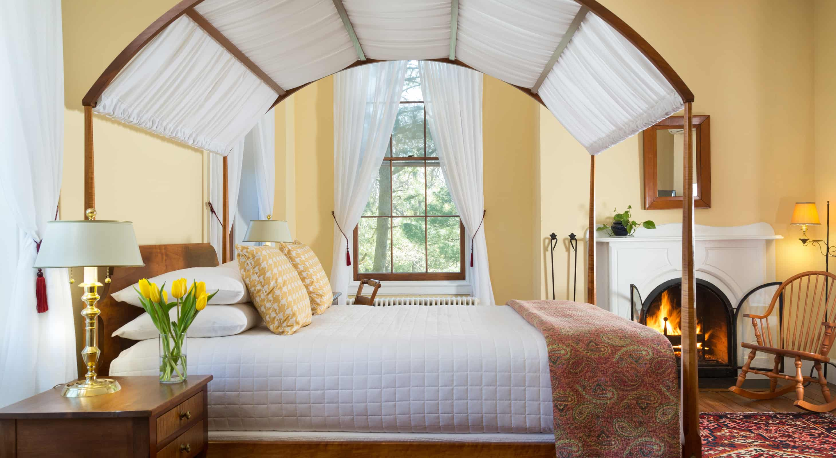 Yellow Room canopy bed and fireplace