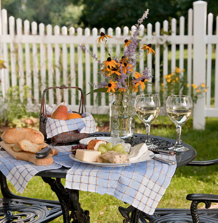 gourmet picnic set up on patio