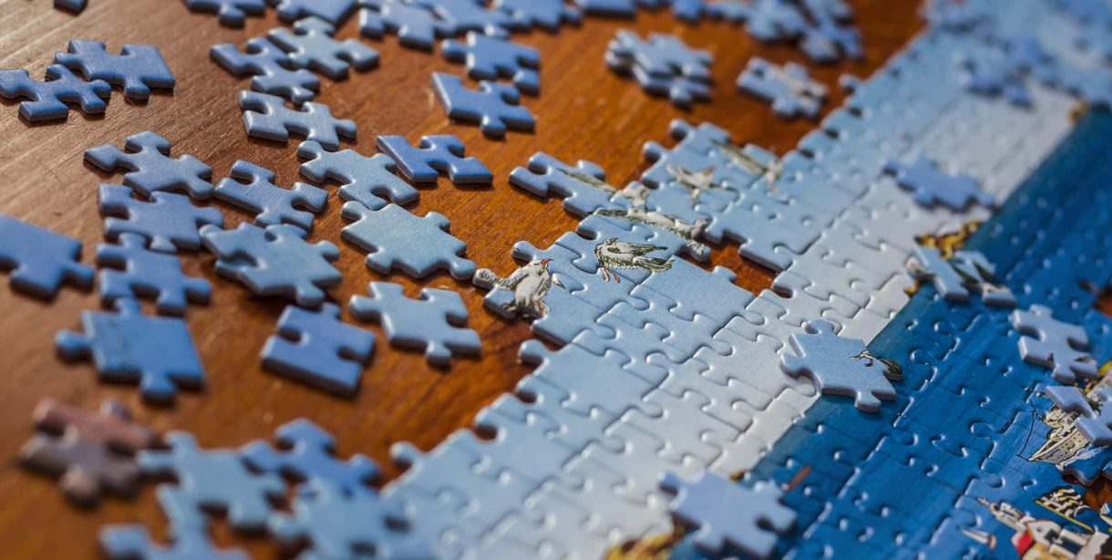 Partially completed puzzle on a wooden table