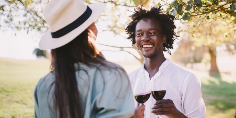 Couple drinking wine and having fun in the outdoors