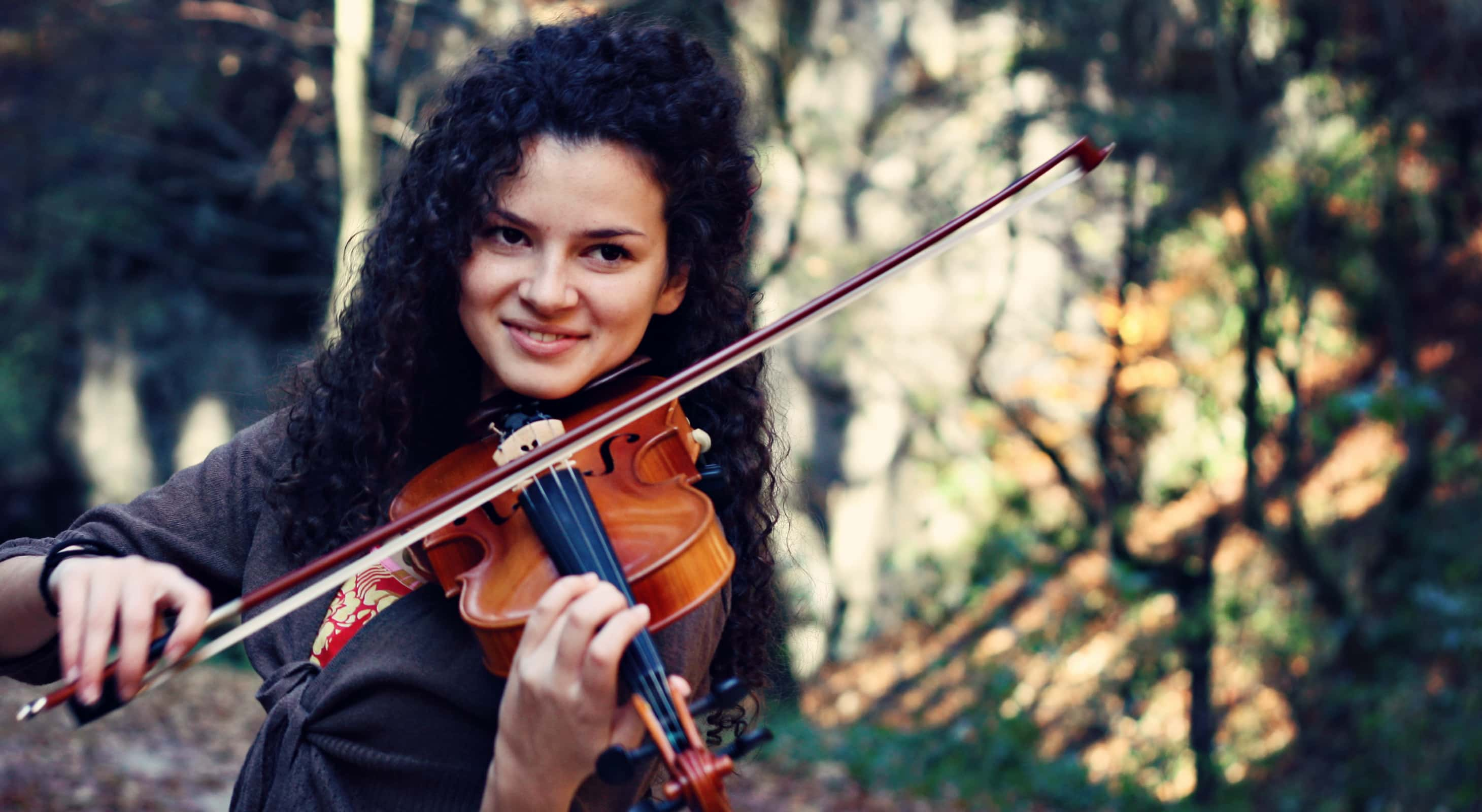 Woman playing violin at outdoor event