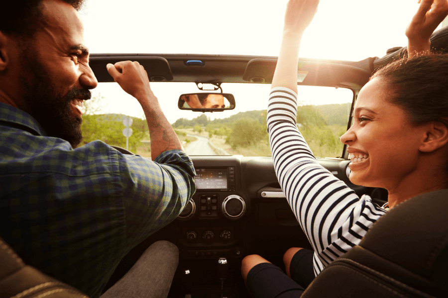 Couple Driving in a Convertible on Romantic Getaway in MD