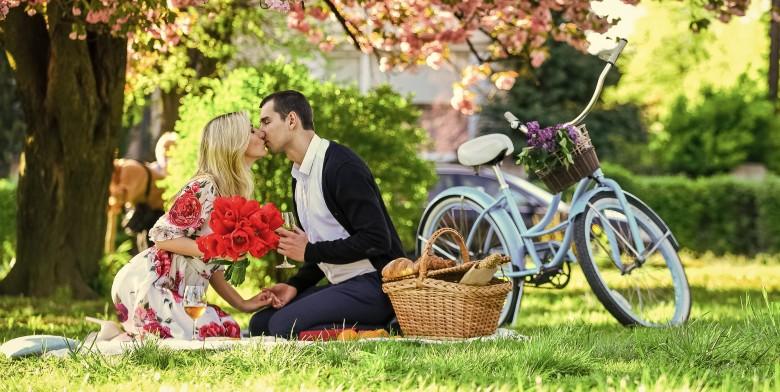 Couple Kissing During Romantic Picnic