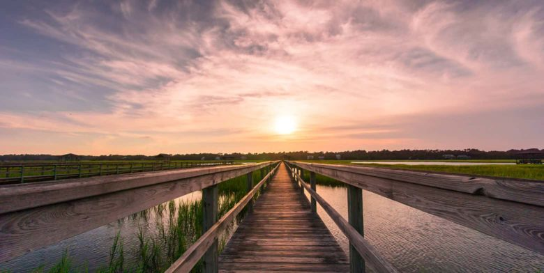 Sunset hike in Maryland over a marsh boardwalk