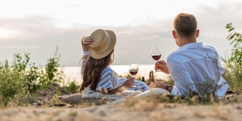 Couple enjoying wine on the beach in Maryland