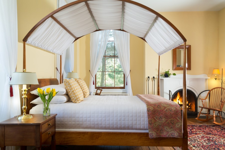 Four-poster bed and fireplace at Maryland bed and breakfast