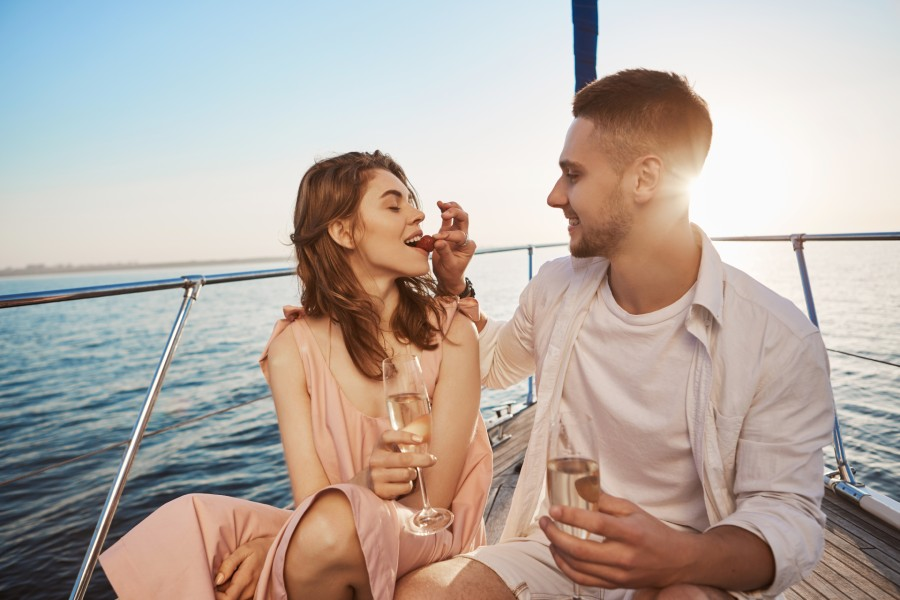 Couple eating strawberries while sailing in Maryland