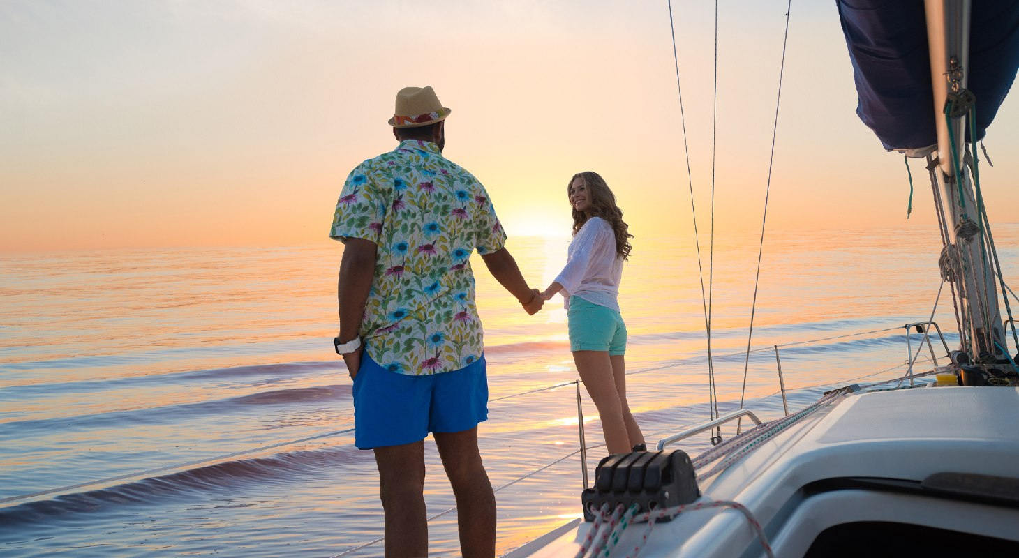 Couple holding hands after sailing in Maryland at sunset
